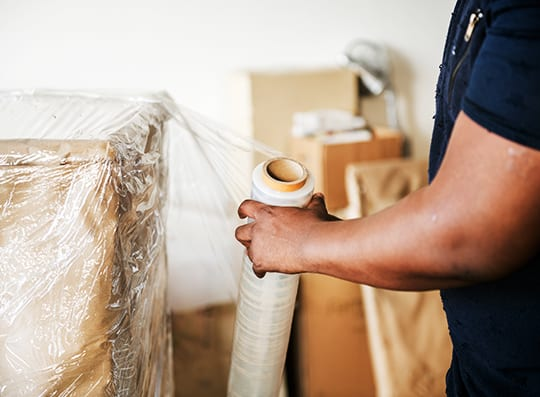 An image of a man packing material